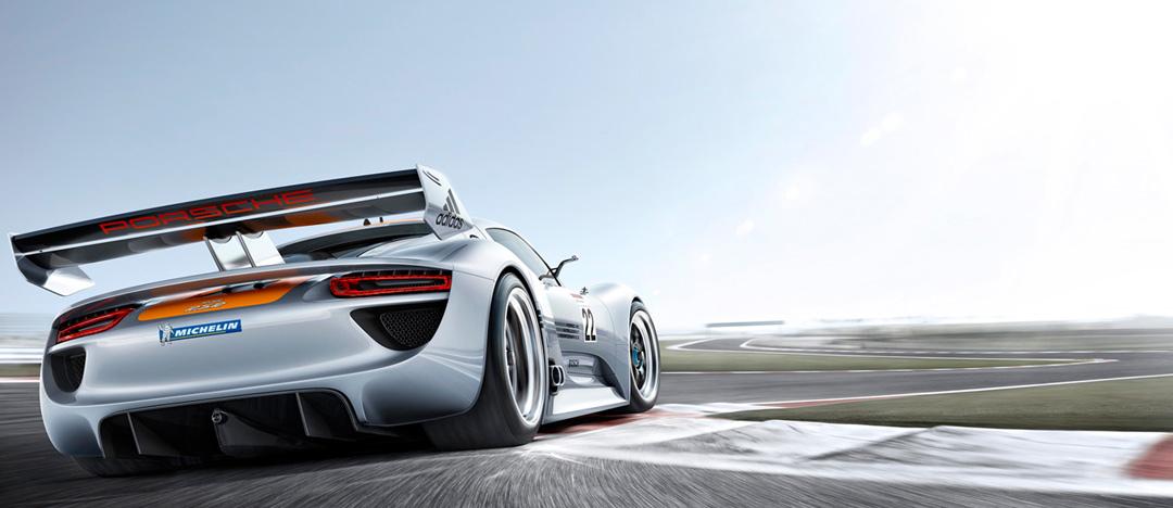 Fotografie Porsche auf Rennstrecke in voller Fahrt von Fotograf Willie von Recklinghausen